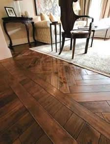 Change the pattern in the flooring. We could do this to separate the foyer from the living room.