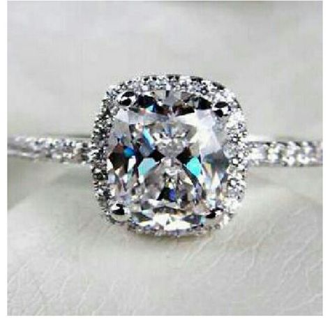 Halo engagement ring. Cushion cut and platinum with a thin band. Yes please :)