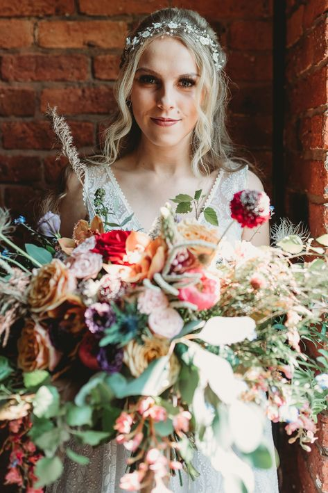 Head to the blog now for boho inspiration in an indutrial venue. Bohemian florals and jewel tones colours. #bohowedding #bohoweddingstyling