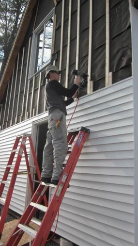 Vinyl Board And Batten Low Maintenance Since It Never Needs To Be Repainted Cottage Exterior Vinyl Siding House Exterior Siding