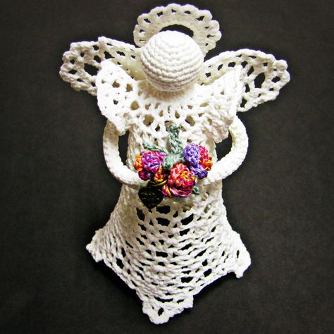 Angels in August Sale at Heritage Heartcraft! Rhapsody Small Handcrafted Angel Figurine in thread crochet. Sweet and Simple, little 'Dee' Angel is on the petite side, standing only about 6 inches tall. Her wings and skirt feature the classic thread crochet pineapple motif.  She is pictured here worked in antique white with a soft mulitcolor bouquet, and looks quite like carved ivory!