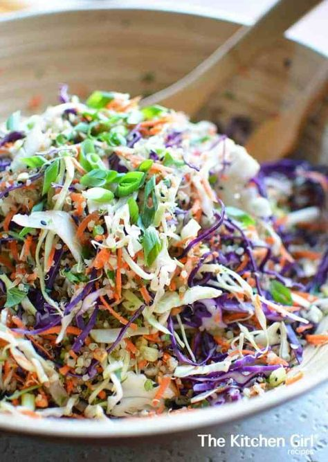 Meal prep and eat clean, raw vegetable quinoa salad. Asian Quinoa Slaw Salad Sesame Ginger Vinaigrette. thekitchengirl.com #asiansalad #orientalsalad #Chinesesalad #mealprep #mealplan #saladforlunch #chinesechickensalad #glutenfree #choppedsalad