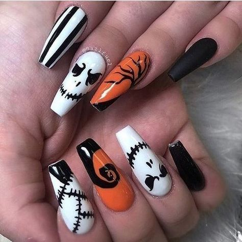 Halloween Nails. Black  white and orange with skeleton skulls.