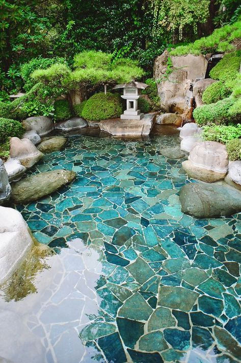 I love the painted hardscape under the shallow pool of water in this beautiful oriental garden. I love the painted hardscape under the shallow pool of water in this beautiful oriental garden.