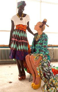 African Textile Outfit, I love what the lady standing is wearing.