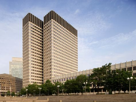 John F. Kennedy Federal Building, Boston, MA. Constructed in 1966 of concrete, granite and glass, it is one of the federal government's most noteworthy Modern designs. It consists of twin 26-story high-rises connected by a glass atrium and attached to a 4-story low rise by a glass-enclosed walkway and a two-story lobby.