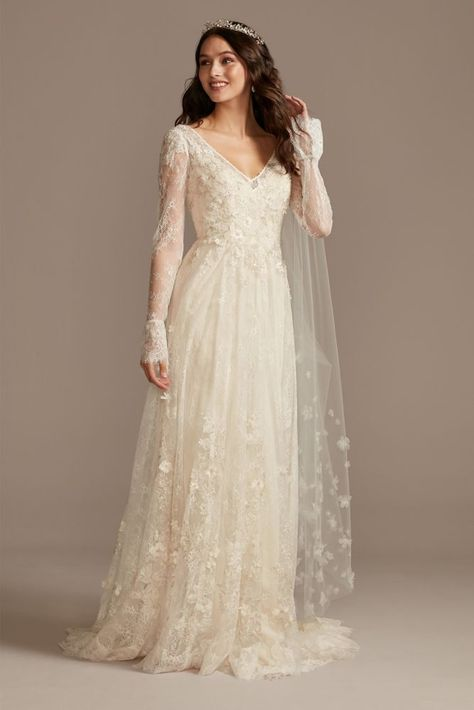 Crafted of airy Chantilly lace and adorned with floral appliques, this A-line wedding dress features a flattering V-neckline, sheer long bell sleeves, and a beautiful chapel train. Wedding Dress Sleeves, Long Sleeve Wedding, Long Wedding Dresses, Tulle Wedding, Champagne Lace Wedding Dress, David Bridal Wedding Dresses, Whimsical Wedding Dresses, Warm Wedding Dress, Wedding Dress Bohemian