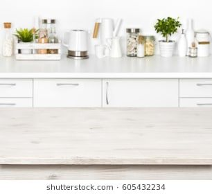 Empty Wooden Table On Blurred Background Of Various Kitchen