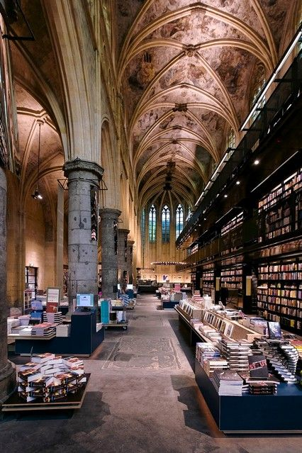 """""""Polare Maastricht, a bookshop housed in a centuries-old Dominican church [in Maastricht, Netherlands] . . . . Dutch design firm Merkx and Girod made dramatic use of the huge space, creating multistory steel shelving."""" """"Truly Novel Bookstores,"""" by Jemima Sissons. Wall Street Journal (July 6 - 7, 2013)."""