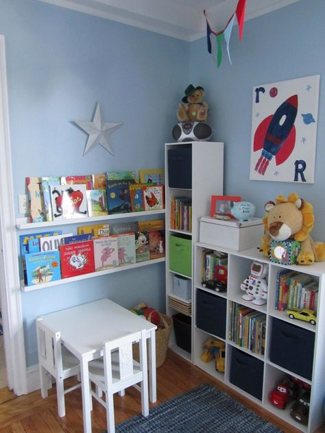 I want a corner of Conner's room like this, but to be a reading corner...just books, and maybe a giant bean bag and pillows!