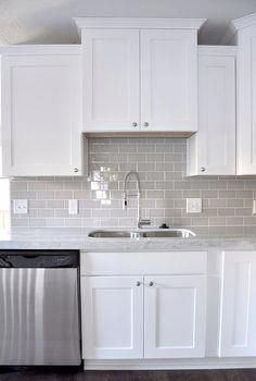 Smoke Gray Glass Subway Tile White Shaker Cabinets Pull Down Faucet Gorgeous Contemporary Kitchen Ki Kitchen Cabinets Decor Kitchen Remodel Kitchen Design