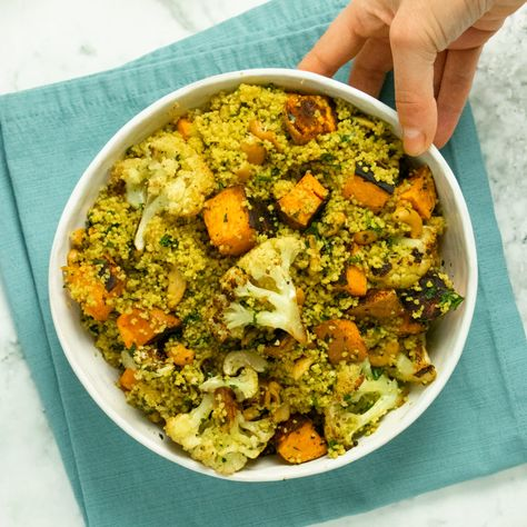 Roasted cauliflower and sweet potato combine with deeply seasoned couscous. Serve this flavorful curried couscous salad as an entree or a side dish! #couscous #salad #healthy #easy #vegan #roastedvegetables #simple