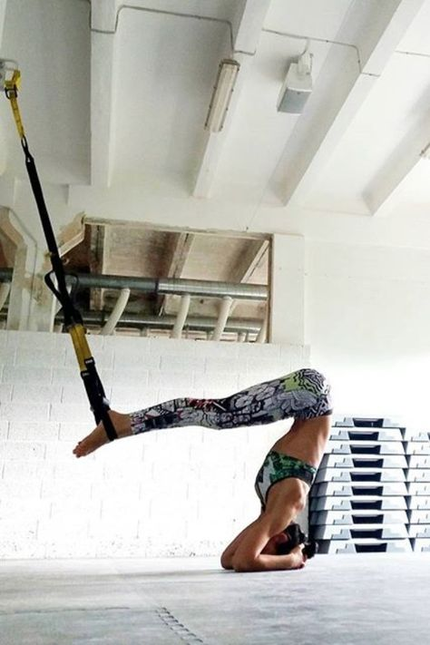 Find out how TRX Suspension Training can take your yoga practice to an even deeper level with these yoga moves. It may be just the equipment that gets you balancing in a headstand!