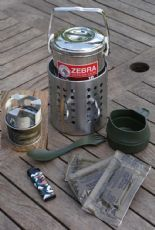 The Bushcraft Store's Hobo Stove is a great self contained unit that is simple to use and versatile as you can use it with solid fuel, wood, meths (with the right selection). It also comes with a top quality Zebra Billy Can that is made of premium stainless steel and will last for years.
