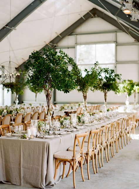 Centerpieces appear to be all foliage. Dramatic without being too costly.