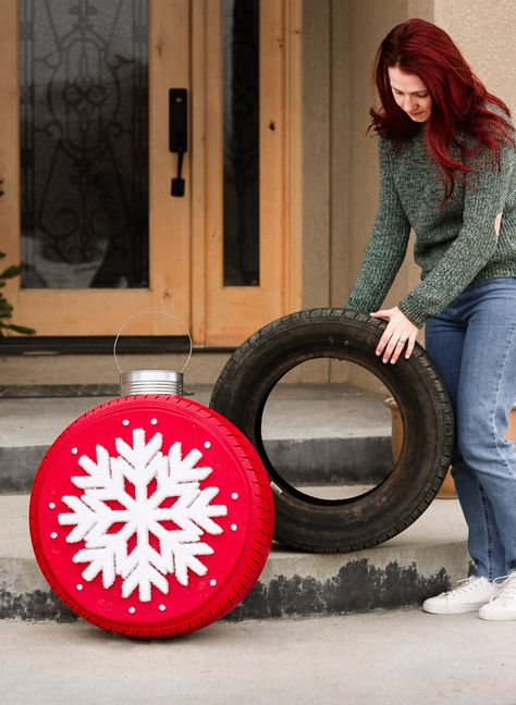 Have an old tire lying around? Turn it into some amazing Christmas decor. DIY Giant Christmas Tire Ornaments in a few easy steps! Large Christmas Ornaments, Outside Christmas Decorations, Christmas Porch, Simple Christmas, Lawn Ornaments, Christmas Kitchen, Prim Christmas, Country Christmas, Christmas Projects