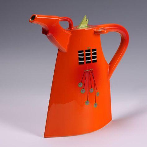 Richard Godfrey orange teapot with a green lid.