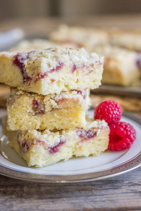 Moist, sweet, and full of almond flavor with a swirl of raspberry preserves and a crunchy crumbly crumb topping. #raspberry #almond #crumbbars #breakfast #dessert