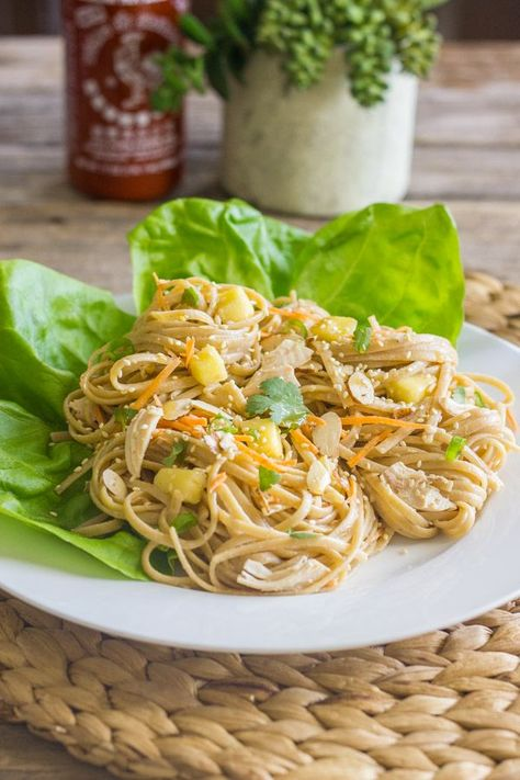 Chicken, sweet mangos, crunchy almonds, and fresh veggies piled high on a bed of sesame noodles. #asianchickensalad #sesamenoodlesalad #chicken #mangos #almonds #sesamenoodles #salad #healthyrecipes