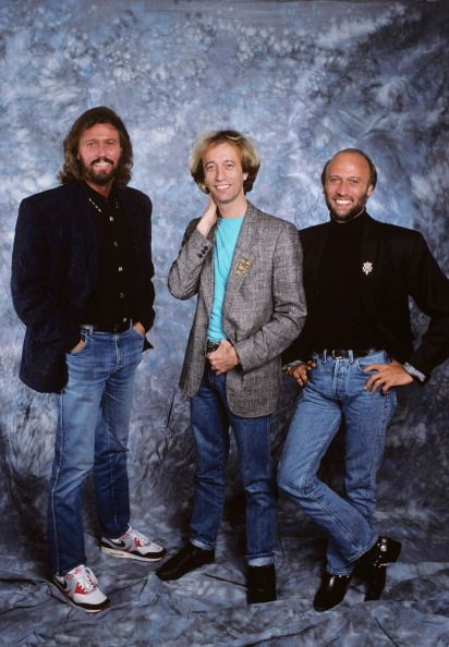 Doctor Barry Gibb, Professor Robin Gibb, and Sir Maurice Gibb
