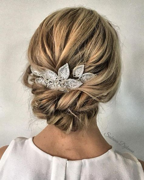Previous Next Amazing updo hairstyle with the wow factor. Finding just the right wedding hair for your wedding day is no small task but... #updosweddinghair