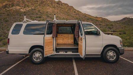 A Big Old Extended Ford E 350 Boho Camper Van Known As Rev Van