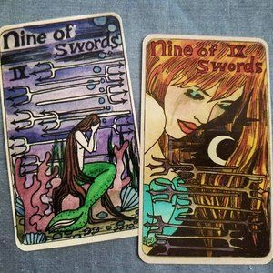 My favorite Nine of Swords...ever! (on the right) - Dame Darcy Mermaid Tarot, 2nd and 3rd edition. #elementsofmagick #tarotbyleeann #tarotcards #intuitivereadings #intuitive #tarotdeck #damedarcymermaidtarot #tarottidbits #tarot #mermaid #ocean #seascapes #comic #popart #sailors #dolphins #seashells #nautical #Atlantis #divination #greensboro #northcarolina #riderwaitesmithtradition #groovy #fun #quirky #playful