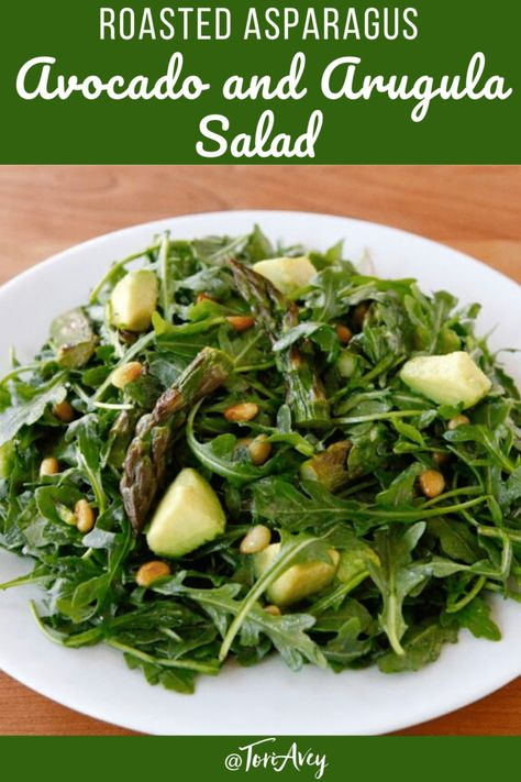 Roasted Asparagus, Avocado and Arugula Salad - Elegant spring salad recipe with toasted pine nuts and sweet citrus dressing perfect for Passover! | ToriAvey.com #salad #veganoption #kosherforpassover
