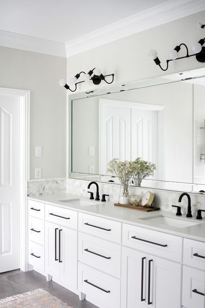 These Modern Black Vanity Sconces Pop So Well Against The All White Back Drop Large Mirror Over A D Double Vanity Bathroom White Cabinetry Modern Black Vanity