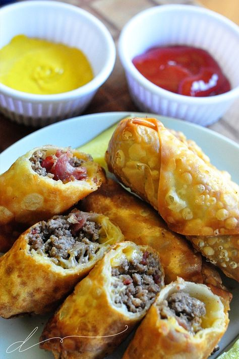 Bacon Cheeseburger Eggrolls.... All I can say about these is wow. I loved, loved, loved them....and my kids did too. Ingredients: ground beef bacon shredded cheese eggroll wrappers vegetable oil for frying (optional) Condiments