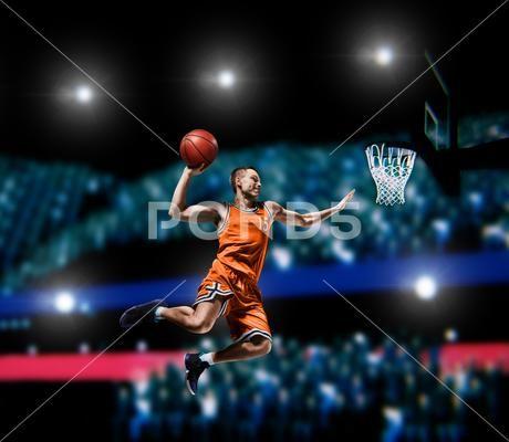 Basketball Player Making Slam Dunk On Basketball Arena Premium Photo 92219559 Basketball Players Slam Dunk Slam Basketball