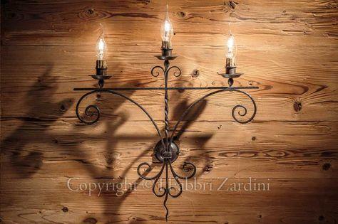 Applique a 3 luci in ferro battuto anticata - Decoro: Volute