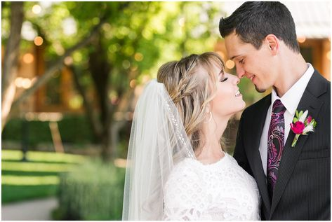 Bride and groom portraits candid moments   white and deep pink florals with black suit and lace dress   Wadley Farms Summer Wedding   Jessie and Dallin Photography #wadleyfarms #utahwedding #utahsummerwedding #utahbride #utahweddings #utahvalleybride #summerwedding