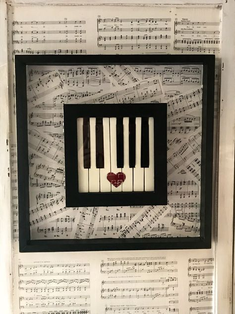 Glass enclosed shadow box piano keys framed art framed into a collage of vintage sheet music