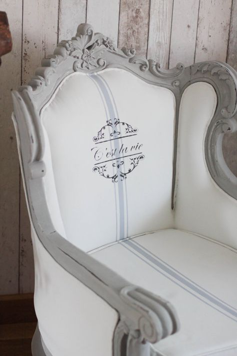 stunning French style Louis armchair throne. The frame has been painted with an Annie Sloan Old white under coat and a Paris Grey top coat. The fabric of the chair has been painted in Annie Sloan Old White, with a detailing in Louis Blue and a stencil in Graphite.