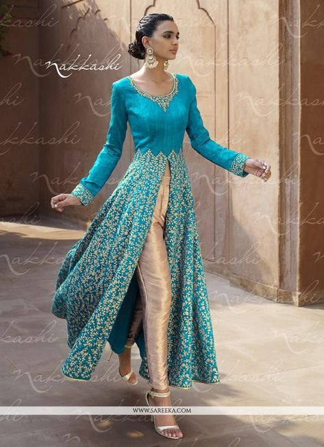 Make the heads flip as soon as you dress up with this turquoise bhagalpuri silk designer suit. Look ravishing clad in this dress that's enhanced embroidered and resham work. Comes with matching bottom...