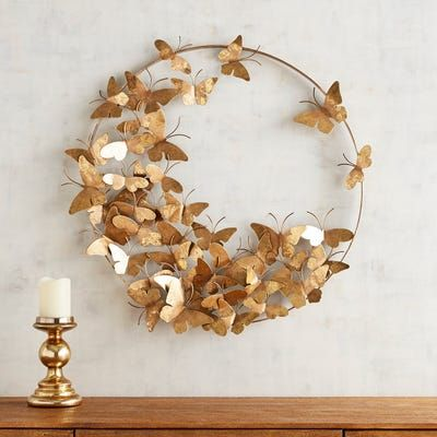 A golden gathering of butterflies seems to take flight in our handcrafted sculptural wall art made of iron and painted to achieve a gilded glow.