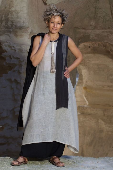 Tunic/dress made of linen gauze natural color with a mixed black linen sarouel-skirt Necklace: Stunning piece of ostrich bone build on rubber and linen stri