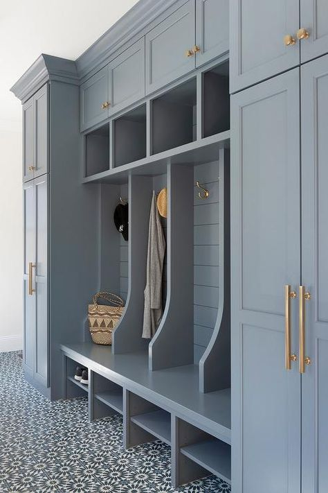 Well appointed blue mudroom boasts white and blue cement floor tiles accenting a blue bench fitted with shoe shelves and positioned against a blue shiplap trim finishing open lockers accented with brass hooks. lockers with bench Mudroom Cubbies, Mudroom Cabinets, Mudroom Laundry Room, Laundry Room Design, Mud Room Lockers, Shoe Storage Mudroom, Cloakroom Storage, Porch Storage, Shiplap Trim