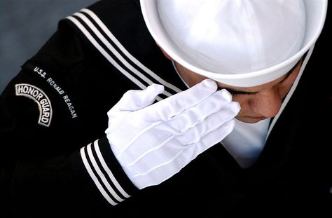 File:US Navy 041202-N-0696M-091 An Honor Guard member renders a salute during a burial at sea ceremony aboard USS Ronald Reagan (CVN 76).jpg