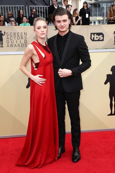 Actors Maika Monroe (L) and Joe Keery attend the 24th Annual Screen Actors Guild Awards.