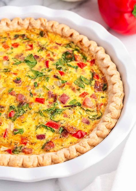 This savory breakfast pie starts with a flaky pie crust and is filled with a mixture of eggs, ham, cheese, veggies and spices. It's an easy-to-make breakfast idea that's always a crowd favorite!