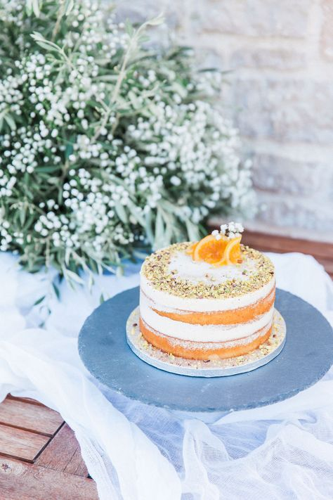 For our olive micro wedding in Lefkas, we reinvented the traditional Greek semolina cake, called Ravani, into a modern naked cake. It is light, with an intense, zesty, orange flavour and Lefkada honey syrup drizzle. Topped with crushed pistachio, this was super tasty Greek cake that did not last long! Planner Lefkas Weddings #destinationweddingcake #greekweddingcake
