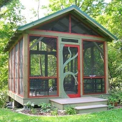 rusty red and green screened gazebo with tree door