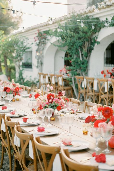 From the editorial, A Spanish Finca Garden Wedding Inspired by Frida Kahlo. We truly can't put into words how much we love this vibrant affair! See it all with your own eyes in the full gallery on SMP.com! ❤️ | Photography: @lillikadphotography #stylemepretty #weddingtable #redwedding #outsidewedding