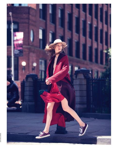Standing out in red, Susanne Knipper wears Krizia wool jacket and oversized wool coat with Converse sneakers
