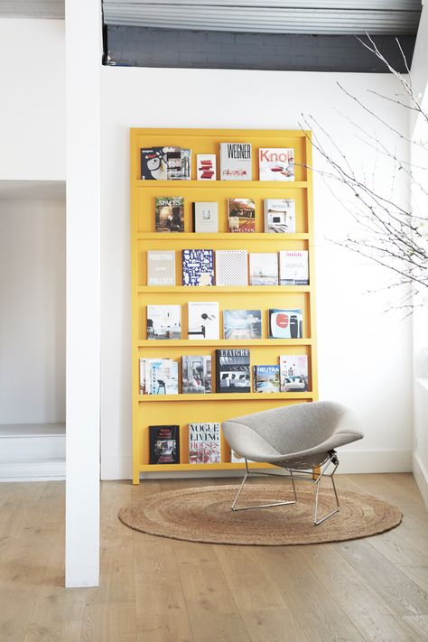Arent&Pyke's Surry Hills head office is complete with a yellow bookshelf, round jute rug, and grey Scandi-style chair
