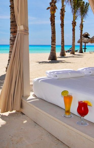 A bed.  Outside.  On the beach.  With fruity beverages.  Yes!!!   #Cancun, Mexico.
