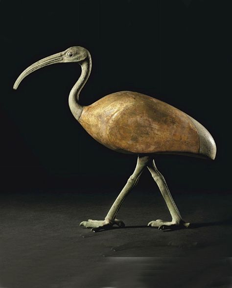 A Egyptian Bronze and gilt wood ibis ~ Late period to Ptolemac-period ~ 664-30-B.C.