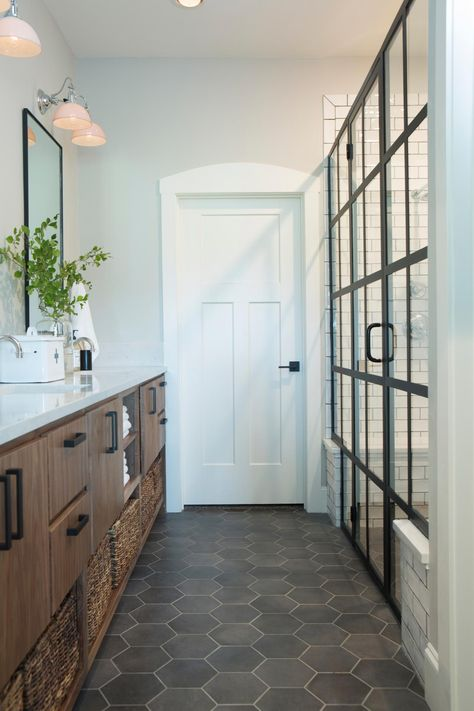 """In a 'Fixer Upper' episode titled """"All American Farmhouse"""", Chip and Joanna Gaines help a wounded war veteran and his girlfriend turn an odd conglomeration of house-and-barn into a stunning country retreat. Fixer Upper Bathroom, Home, Bathroom Decor, House Bathroom, Bathrooms Remodel, New Homes, House, Farmhouse Master Bathroom, House Interior"""